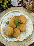 Falafel  Deep-Fried Balls or Patties Made from Ground Chickpeas and or Fava Beans  Arabic Countries