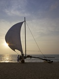 Fisherman and Oruvas (Traditional Outrigger Dug-Out Canoe)  on Negombo Beach  Sri Lanka  Asia