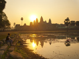 Tourist Watching Sunrise at Angkor Wat Temple  UNESCO World Heritage Site  Siem Reap  Cambodia