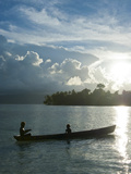 Boys in a Canoe in Backlit in the Marovo Lagoon  Solomon Islands  Pacific