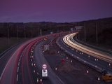 Roadworks  Lane Closures and Speed Limits on M5 Motorway at Dusk  Near Birmingham  England