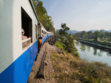 Tourists on a Train Ride on the Death Railway Along the River Kwai  Kanchanaburi  Thailand
