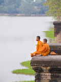 Buddhist Monks Sitting at Angkor Wat Temple  Angkor  UNESCO World Heritage Site  Cambodia