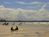Surfers with Boards on Perranporth Beach  Cornwall  England