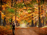 Kid with Backpack Walking in Fall Colors