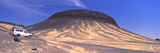 Suv Moving in a Desert  Black Desert  Bahariya Oasis  Egypt