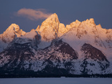 A Cloud Trails Off the Summit of the Grand Teton at Sunrise