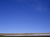 A Long Fence under a Blue Sky