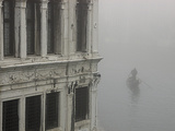 A Gondola Glides Through a Canal in Fog