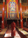 A Male Monk Offers Prayers in Batang Monastery