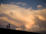 A Mother and Her Young Son Watch as a Thunderstorm Nears