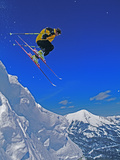 A Skier Jumps a Cornice at Exclusive Yellowstone Club Ski Area  Montana