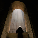 A Franciscan priest gazes at the Tomb of Christ in Jerusalem's Church of the Holy Sepulchre