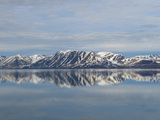 Snow and Mountains Reflected in Still Arctic Water