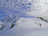 Off-Piste Skiers Hike Below Mount Shuksan  Near Mount Baker Ski Area