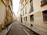A Small Street Lined with Traditional Parisian Buildings