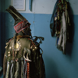 A Tuvan Shaman in Her Ceremonial Headdress and Coat