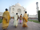Women in Traditional Dress Approach the Taj Mahal