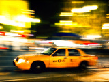 A NY Taxi Cab Rushes By