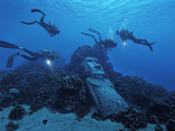 Tourists Diving on Easter Island's Reef Encounter a Fake Moai