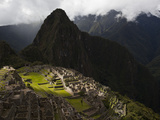 Sunlight Strikes Machu Picchu Through a Break in the Clouds