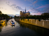 The Seine at Sunset with Notre Dame in the Background and a Tour Boat