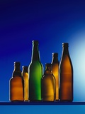 Assorted Beer Bottles Against Blue Background