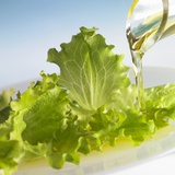 Oil Running onto Lettuce Leaves