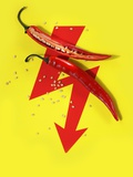 A Sliced-Open Chilli Pepper on a Red Arrow