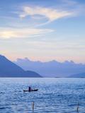 Indonesia  Sumatra  Samosir Island  Tuk Tuk  Man Fishing in Dug Out Canoe on Lake Toba