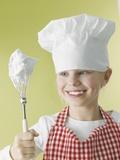 Girl in Chef&#39;s Hat and Apron with Beater
