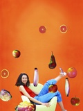 Woman Sitting in Chair Surrounded by Flying Fruit and Vegetables