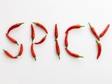 The Word 'SPICY' Written in Red Chillies