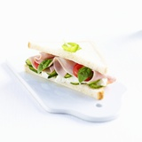 A Ham  Camembert  Tomato  Cucumber and Basil Sandwich