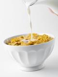 Pouring Milk on Cornflakes