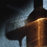 Shadow of Glass of Wine and Wine Bottle on Wall