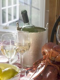 White Wine Bottle in Ice Bucket  Wine Glasses  Lobster  Lemon