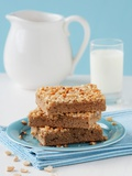 Three Slices of Peanut Cake Tray Bake on a Plate