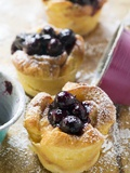 Individual Bread Puddings with Cherries and Icing Sugar