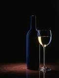 A Glass of White Wine and a Wine Bottle