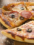 Pizza with Salami  Cheese and Olives  Pieces Cut