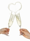 Clinking Glasses of Sparkling Wine (With Heart-Shaped Splash)