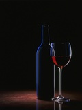 A Glass of Red Wine and a Wine Bottle