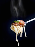 Linguine with a Minced Meat Sauce  Tomatoes and Basil on a Fork