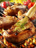 Brushing Pork Chop on Barbecue Rack with Oil