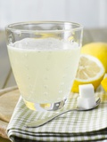Hot Lemon with Sugar Cubes  Lemons in Background