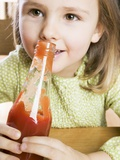 Girl Holding a Bottle of Ketchup