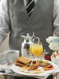 Butler Serving Breakfast Tray with Bacon  Eggs and Toast