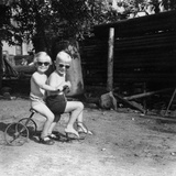 Two Children on a Tricycle