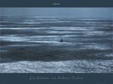 Un homme  un bateau  l'océan